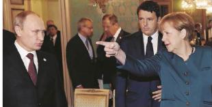 Merkel indica la via a Putin con dietro Renzi.